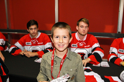A young fan collecting autographs from his favourite OHL team.