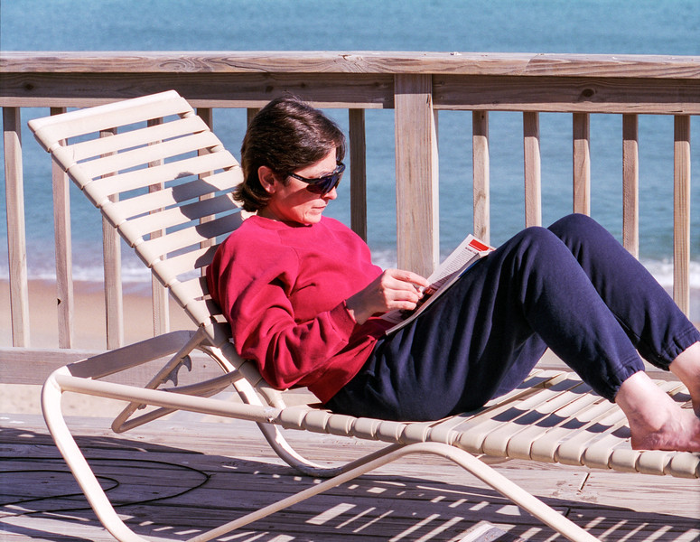 Mercedes reading on the deck - OBX 1998