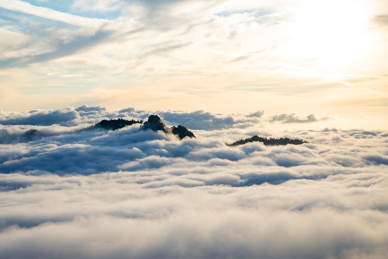 A ridge emerges out of the swirling clouds in the North Cascades of Washington.