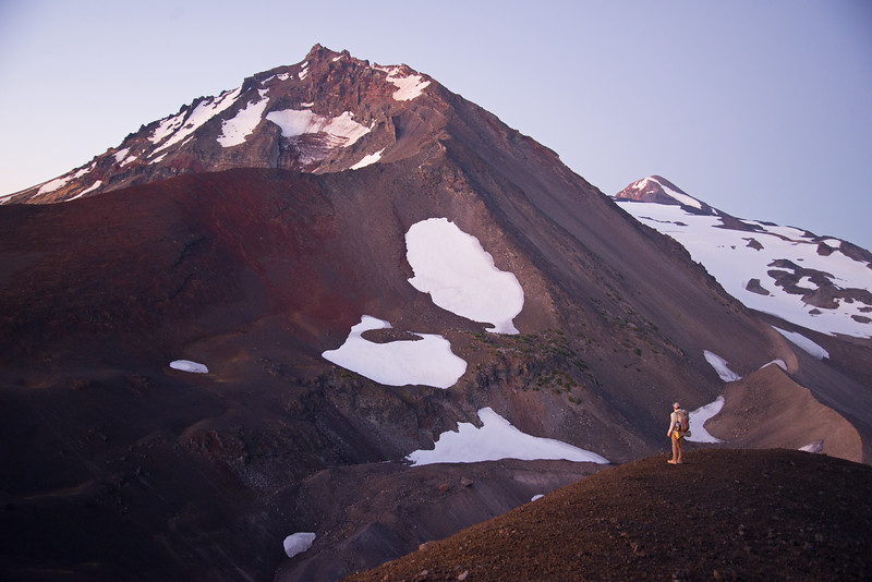First light over North and Middle Sister, two volcanoes, deep in the Three Sisters Wilderness in Oregon.