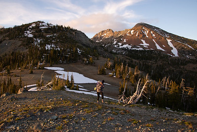 Backpacking along a windy alpine ridge in the Alpine Lakes Wilderness in Washington.