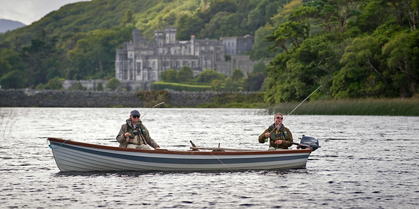 Anglers in boat  fish for seatrout and salmon at Kylemore Abbey, Connemara, Ireland