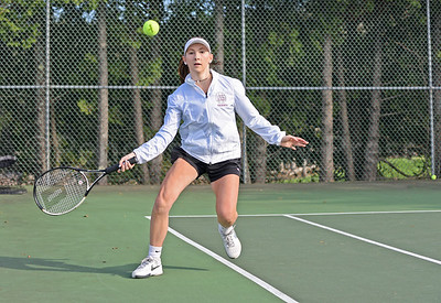 Libby Weed measures a return against Lee Academy in a first doubles match. Photo by Franklin Brown