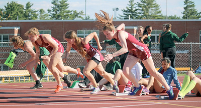 From left, Bella Cimeno, Eliza Broughton and Mazie Smallidge pack a 1-2-3 punch in the 100 meter hurdles at the Hancock County Meet in Ellsworth on May 19. The girls and boys teams finished second, behind Mount Desert Island, and compete in the Penobscot Valley Conference meet on Monday, May 29, in Dover-Foxcroft. Photo by John Richardson