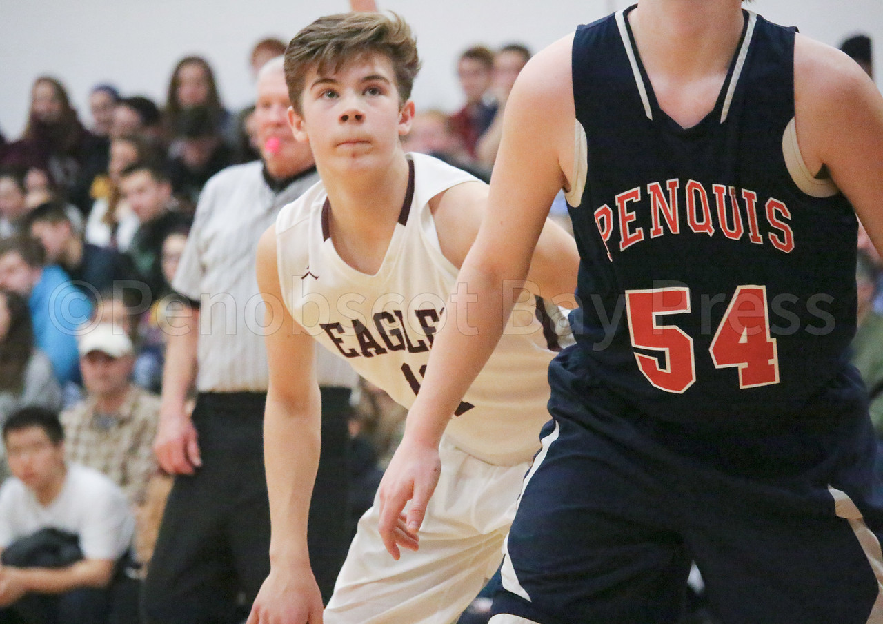 Caden Mattson boxes out the foul shot. Photo by Anne Berleant