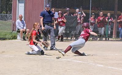 Cassidy Bulleman slides into home to score for the Eagles against Dexter on May 20. Photo by Anne Berleant