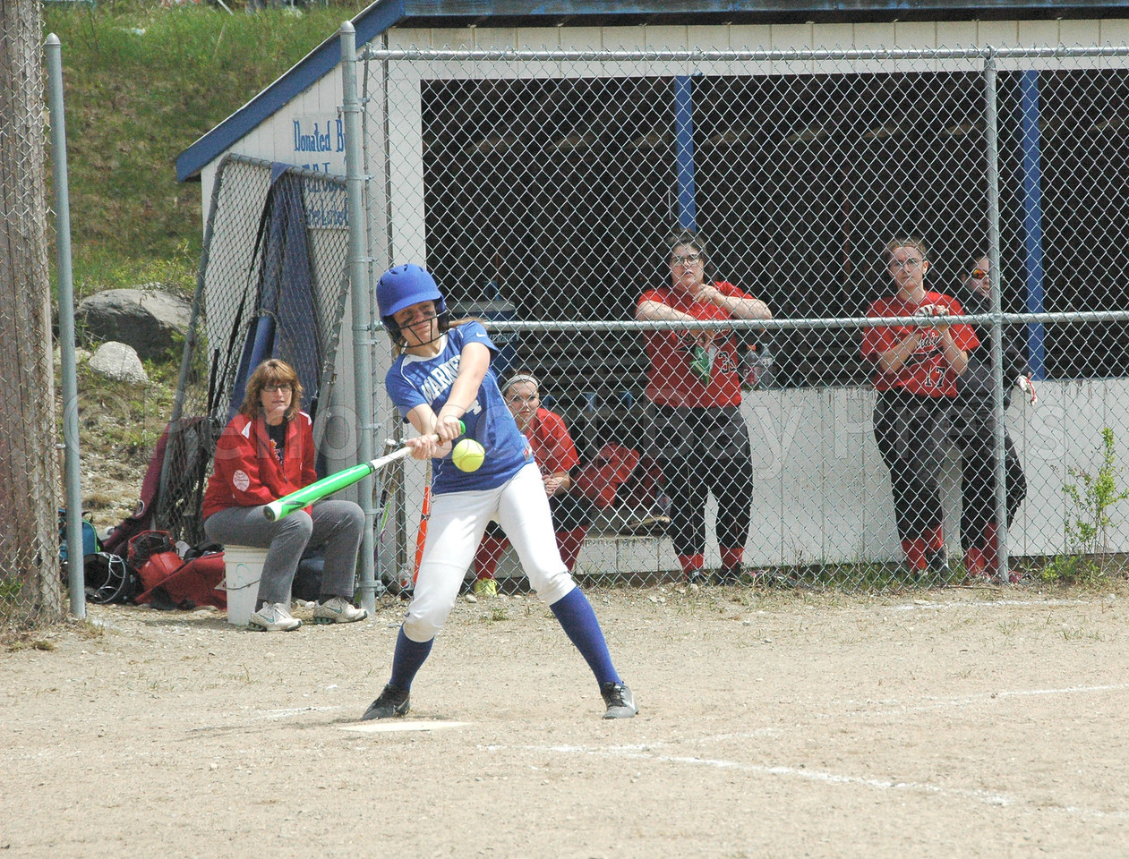 Katie Hutchinson tags a hit against Katahdin. Photo by Jack Scott
