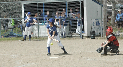 Abby Stinson hits low. Photo by Jack Scott