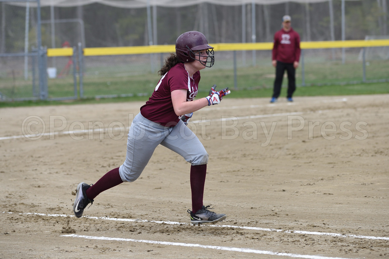 Sophia Steinbarger runs for first base and is out.  Photo by Franklin Brown