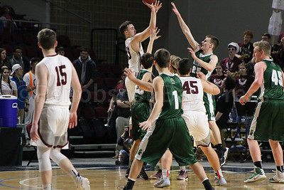 Jarrod Chase takes a contested shot. Photo by Anne Berleant