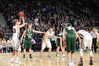 Percy Zentz sets up the foul shot that would tie the game deep in the fourth quarter; Stefan Simmons boxes out. Photo by Anne Berleant