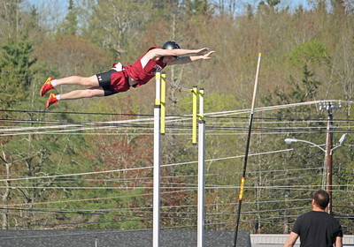 "Alex Taylor-Lash soars 10'06"" to take first place in the pole vault at the Hancock County meet in Ellsworth on May 19. Photo by John Richardson"