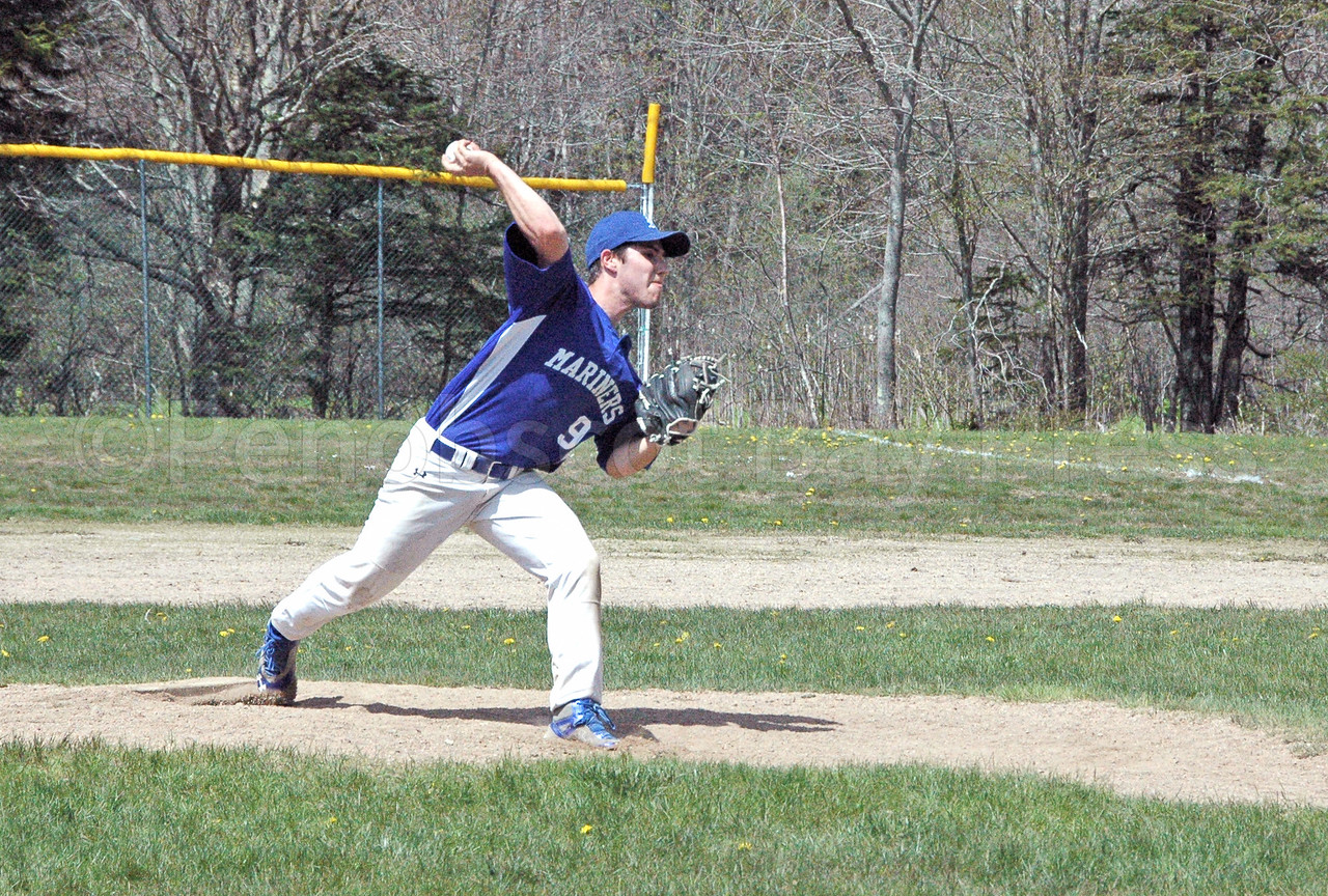 Silas Bates winds up a pitch against Katahdin. Photo by Jack Scott