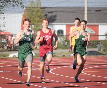 Cameron Gordon races the 400 meter relay event. Photo by John Richardson