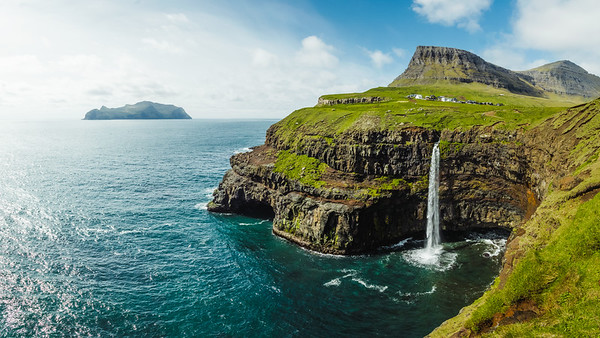 Múlafossur falls, Gásadalur village and Mykines island in the background
