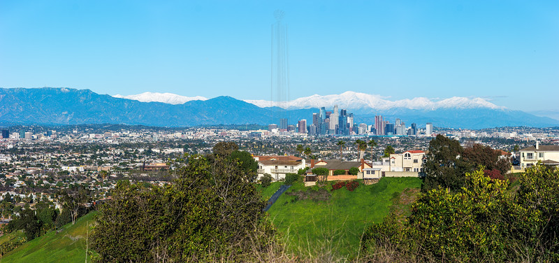 Downtown Los Angeles with the snowcapped San Gabriels.