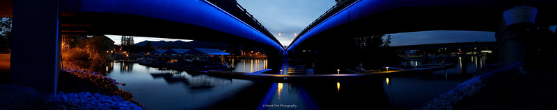 DF.3003 - Iconic blue lights of the I-95 overpass and marina - panoramic at night, Sandpoint, ID.