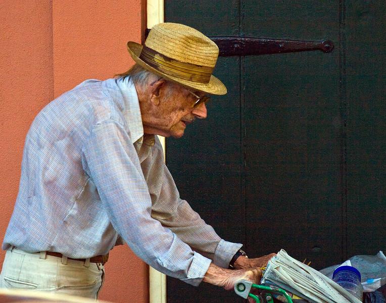older gentleman pushing grocery cart in rain  New Orleans