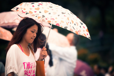 Girl with the Umbrella A girl in Macau carrying an umbrella beneath the Ruin's of St Pauls