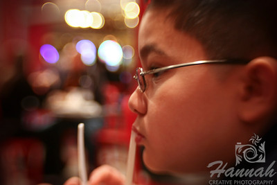 A boy drinking from a straw. Shot with the Lensbaby Composer with Sweet 35 Optic.  © Copyright Hannah Pastrana Prieto