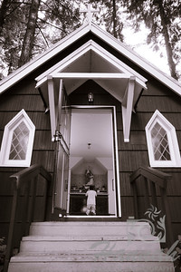 "A boy praying at St. Anne's Chapel at ""The Grotto"" in Portland, Oregon  © Copyright Hannah Pastrana Prieto"