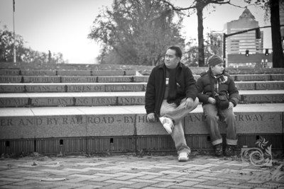 Father and Son sitting in black and white  © Copyright Hannah Pastrana Prieto