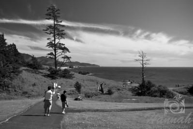 Father and son walking towards the beach  © Copyright Hannah Pastrana Prieto