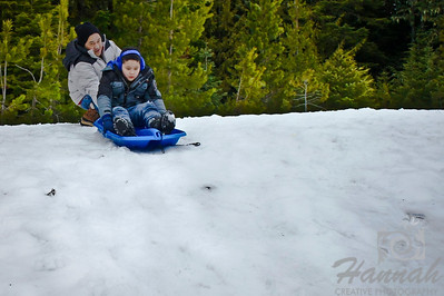Father and Son sledding  © Copyright Hannah Pastrana Prieto