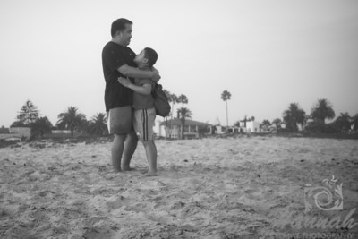 Father and son hugging on the seashore  © Copyright Hannah Pastrana Prieto