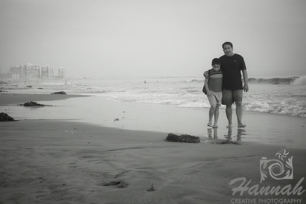 Father and Son walking along the shore  © Copyright Hannah Pastrana Prieto