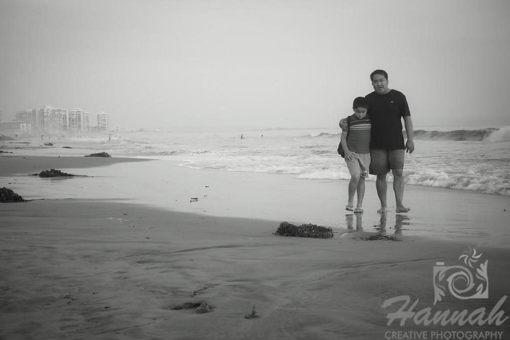 Father and Son walking along the shore  © Copyright Hannah Pastrana Prieto