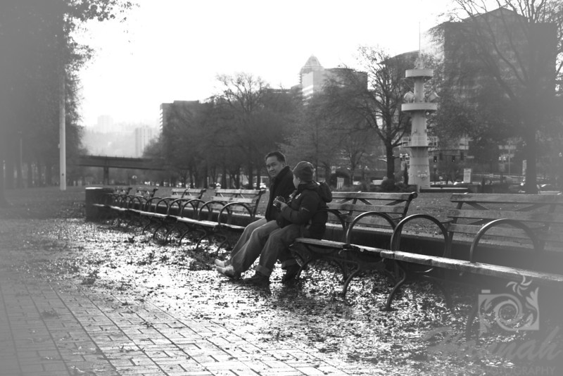 Father and Son sitting on a bench  © Copyright Hannah Pastrana Prieto