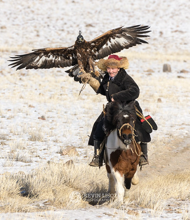 Jin Alas rides with his golden eagle