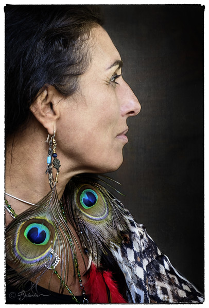 Woman with the Peacock Feathers