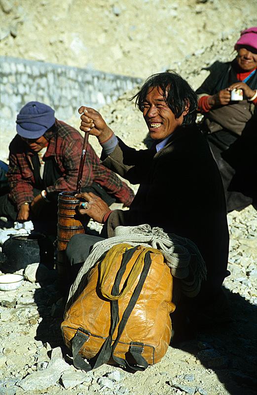 Yak Butter Tea / Lhasa-bound pilgrims preparing yak butter tea / Kham, Tibet
