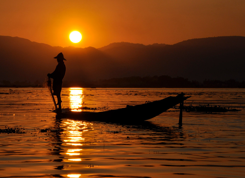 Silhouette of a fisherman in the sunset at Inle lake in Burma