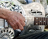 Closeup of guitarist's hand playing a steel resonator guitar