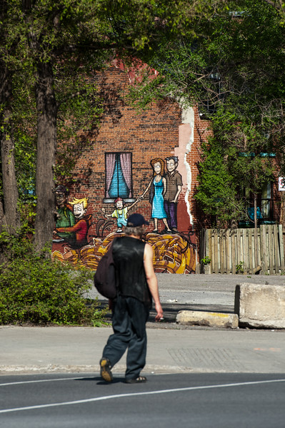 Homeless Man In Front Of Family Mural Montreal Canada