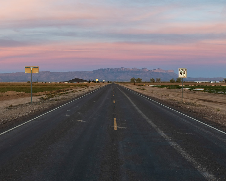 Open Road At Sunset with Guadalupe Mountains National Park in Background Texas