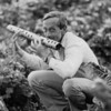 Andre Gregory with irrigation pipe as flute