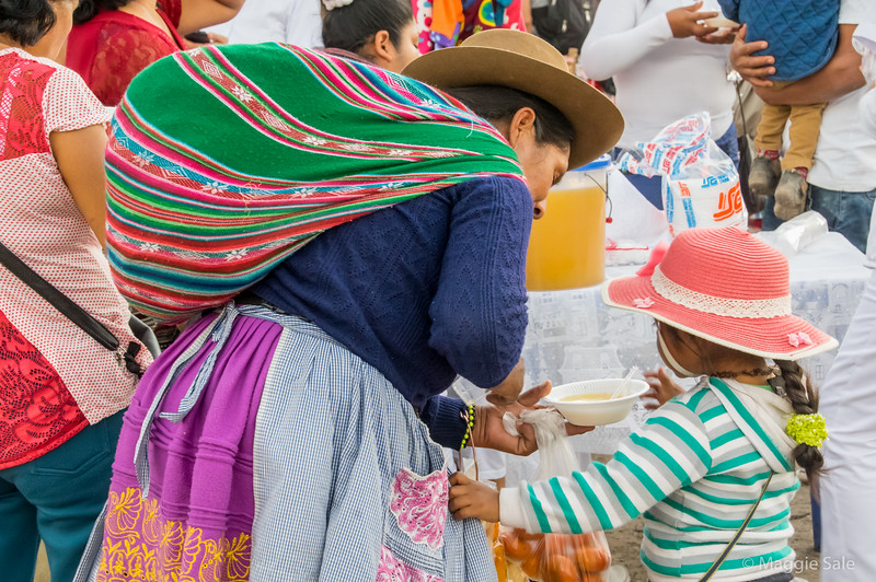 A mother and daughter at the open air market in Nazca.