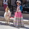 A girl and her llama in the town centre of Maca in the Colca valley.