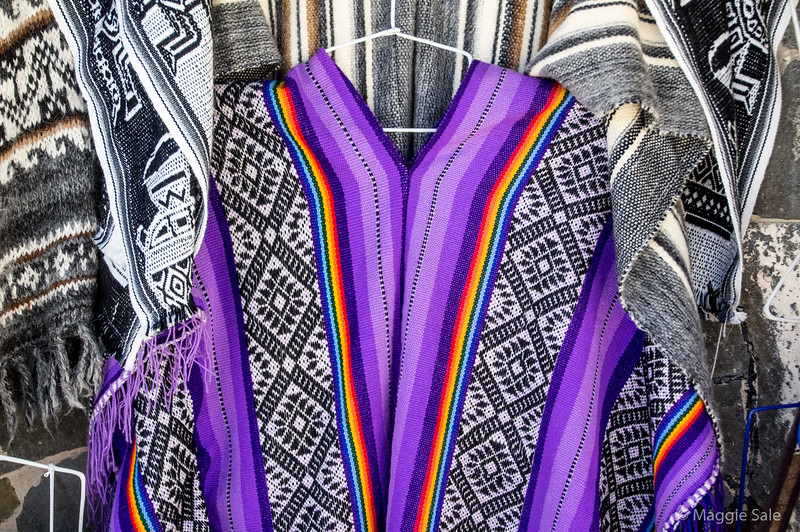 Details of the ponchos at the market in Maca.
