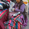 Seller at an outdoor market in Cusco