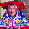 A restaurant greeter dressed in national costume in Cusco.