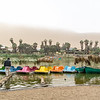 The low lying clouds hadn't cleared when we arrived so the dunes were misty and I walked around this oasis where they were preparing the boats for the tourists.
