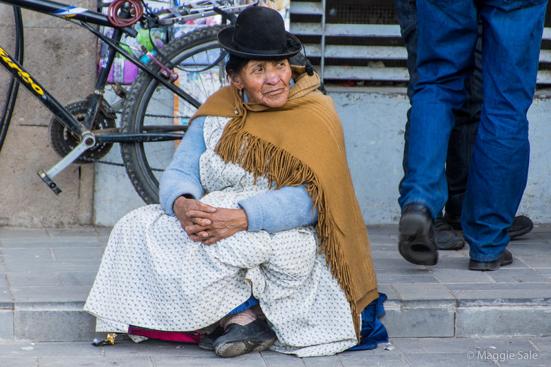 Lady in Puno. The ladies wore multiple layers - it wasn't cold, around 18 - 23 C most of the time, but it's their winter and they dress as if it were nearer 5C!