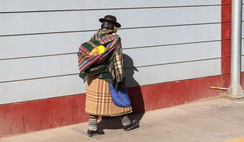 Bus shot of a women in traditional dress in Juliaca.