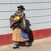 Bus shot of a women in traditional dress in Juliaca.