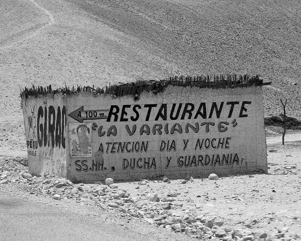 Restaurante sign on deserted building along Pan American Highway Peru